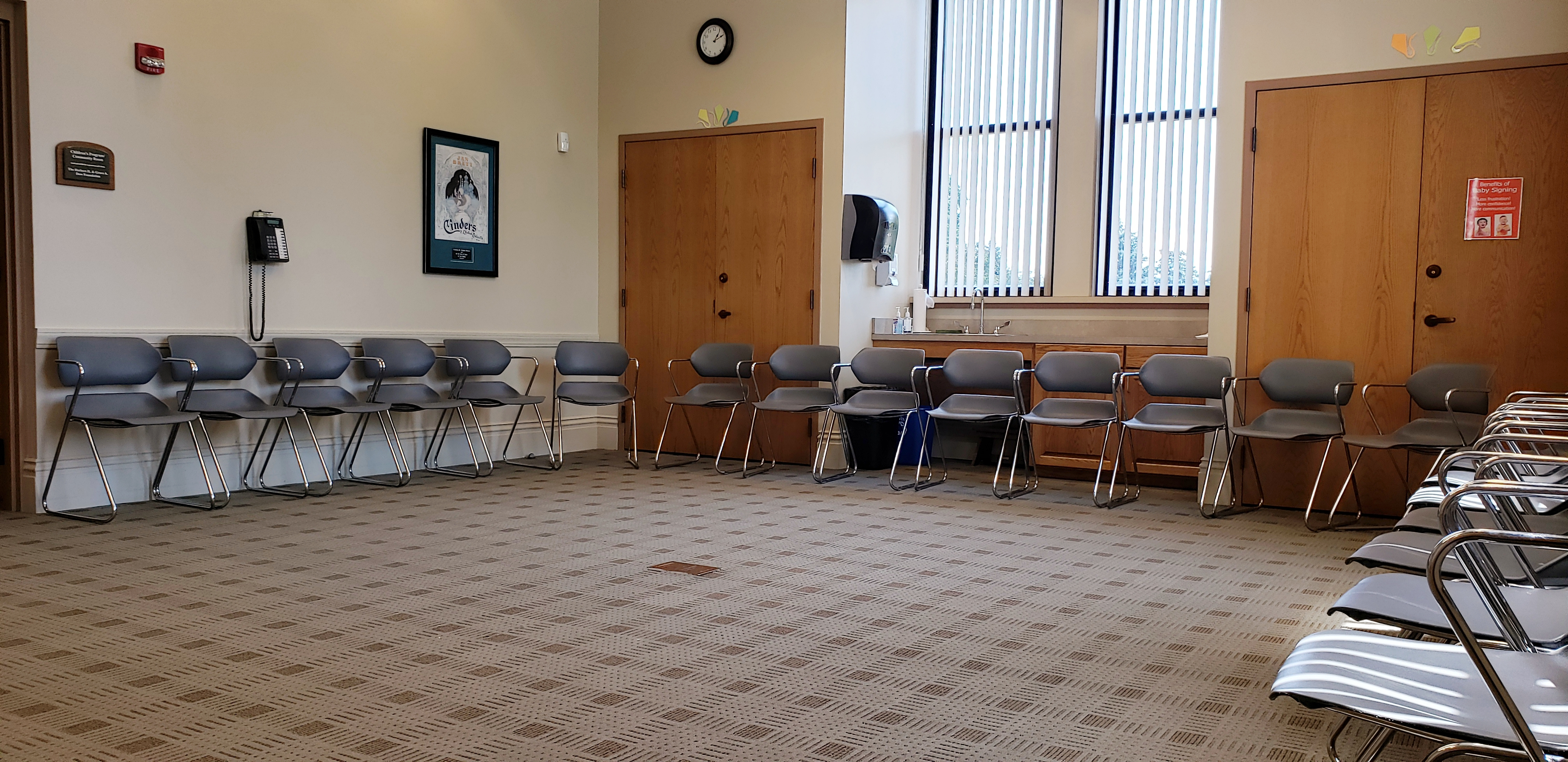Interior shot of the Sage Community Room with chairs lined up against walls