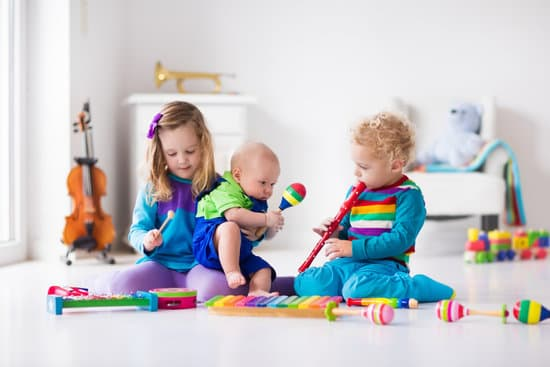 very young children playing with musical instruments