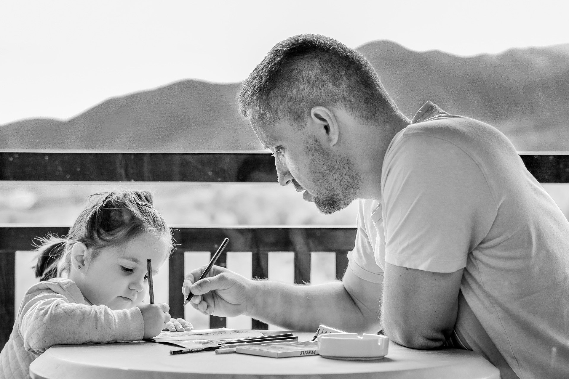 Dad and daughter writing together