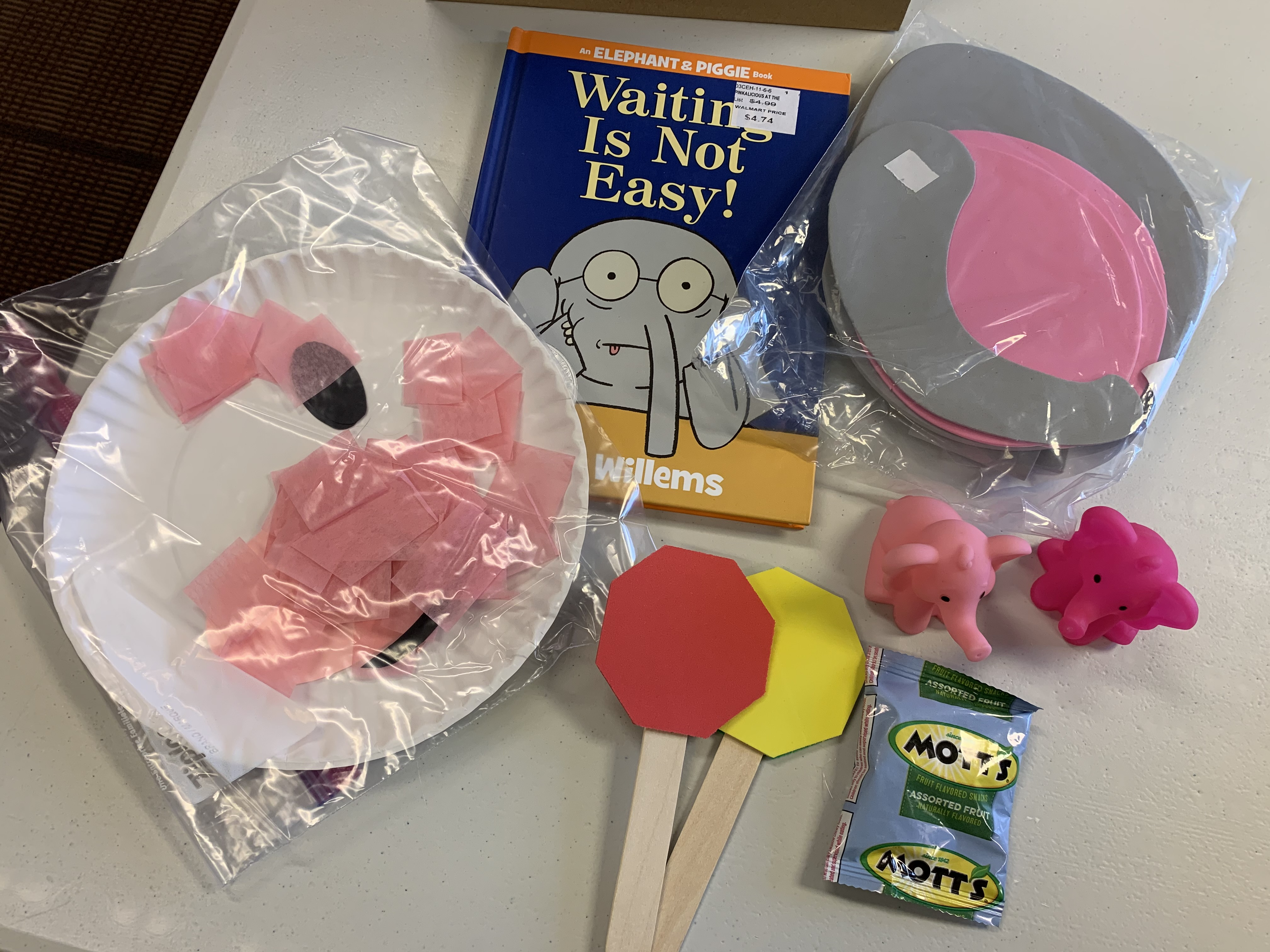 Early Reader bag contents: 2 crafts, activity, book, toys, and fruit snacks