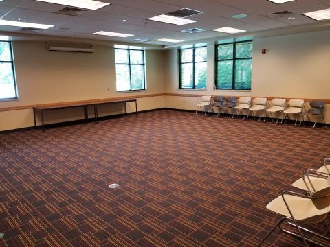 Interior photo of Auburn Community Room with an open room setup